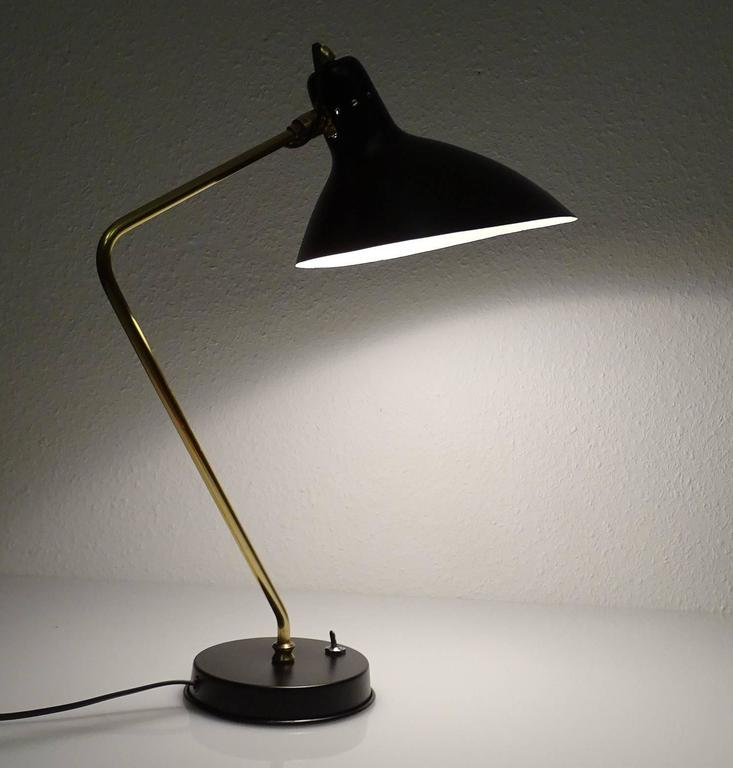 All our light´s electricals are professionally checked and tested for worldwide use A very rare satinated black and brass table lamp by Jean Boris Lacroix . circa 1955-1960 with its signature elongated shade and bend brass stem, extremely rare early