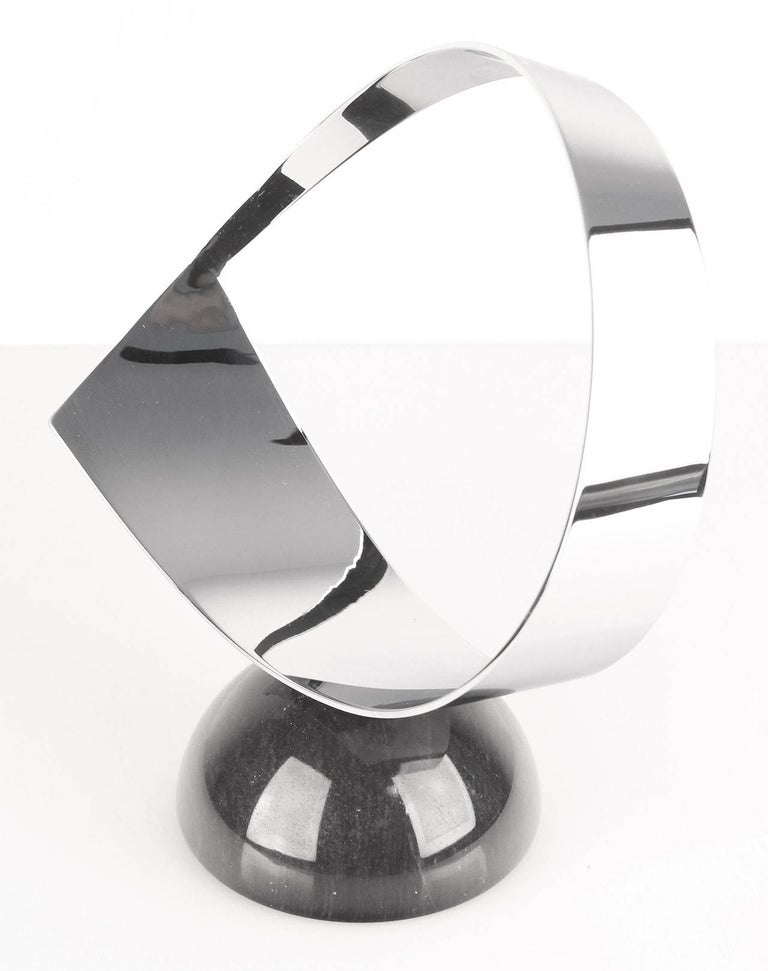 A chrome and marble abstract Curtis Jere sculpture, circa mid-1980s.