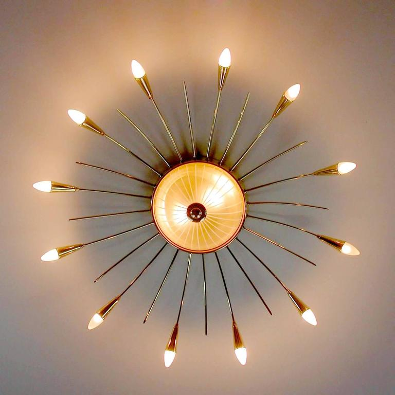 Very large italian mid century modern sunburst chandelier with illuminated glass dome  5.91 in.H / 15 cmH Diameter 42.13 in. (107 cm) (with bulbs) 12 candelabra, 40 watts each + two standard bulbs, 60 watts each