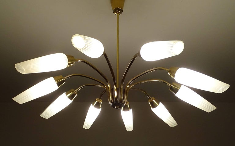 Mid-Century Sputnik  chandelier with ten spokes, opaline glass shades with light stripe patterns on a brass and black enameled structure 24.8 in./ 63 cm H Diameter 35.43 in. (90 cm) Ten candelabra size bulbs 40 watts each -rewired   Vintage Italian
