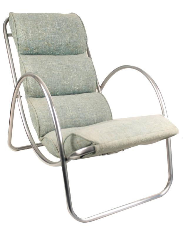 Art Deco lounge chairs, made by the Halliburton Company, circa 1930s.   Richard Neutra used examples of these chairs for some of his earliest modernist commissions.   All aluminum frame and original cushions, the light turquoise-greenuish-blue