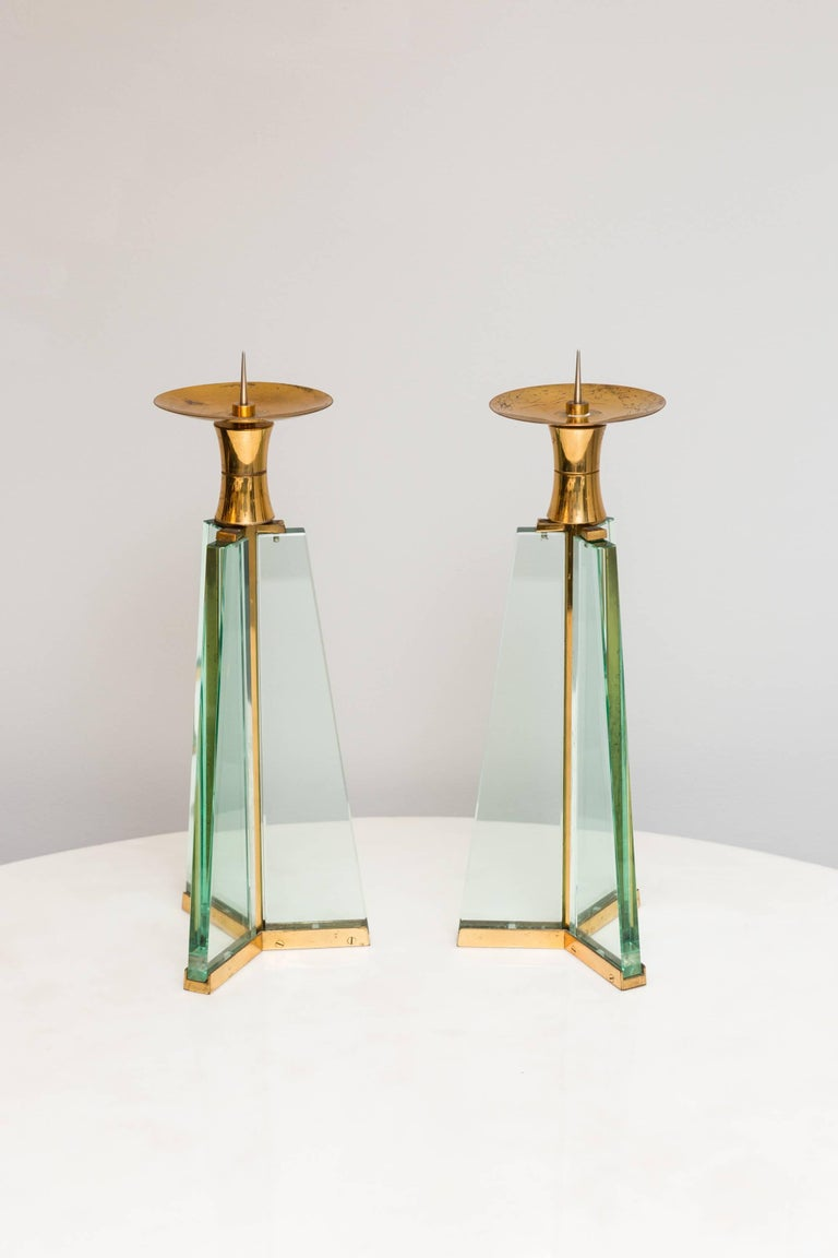 Rare pair of Fontana Arte, candle holder, glass, brass. Very good vintage condition.  No chips in the glasses, light patina on the brass.  Very rare to find!