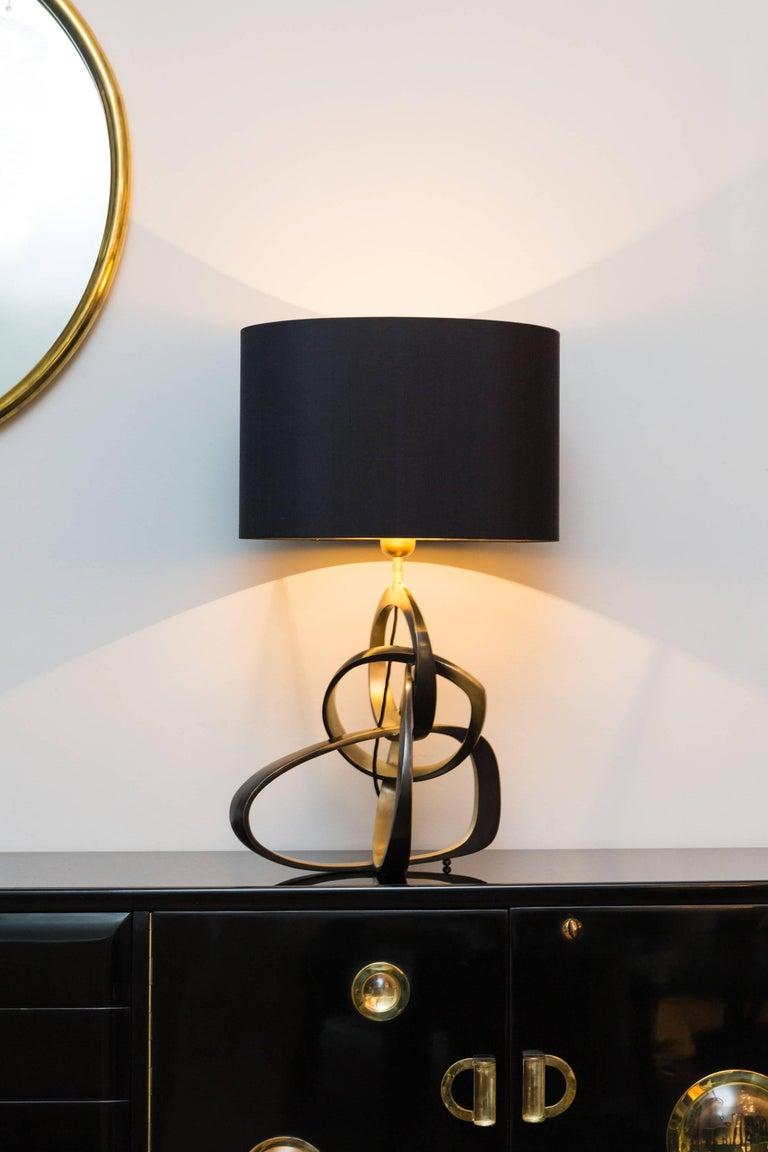"Organic table lamp ""Rings"" limited edition of 10, handmade bronze, patina in dark bronze, black silk shade inside gold, black cotton cord.
