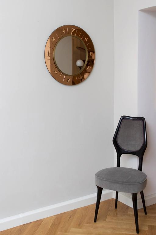 Rare wall mirror by crystal art, Italy, circa 1960, cut bronze colored mirror glass, brass framed mirror. Measure: Diameter 60 cm, depth 3 cm. Perfect condition!