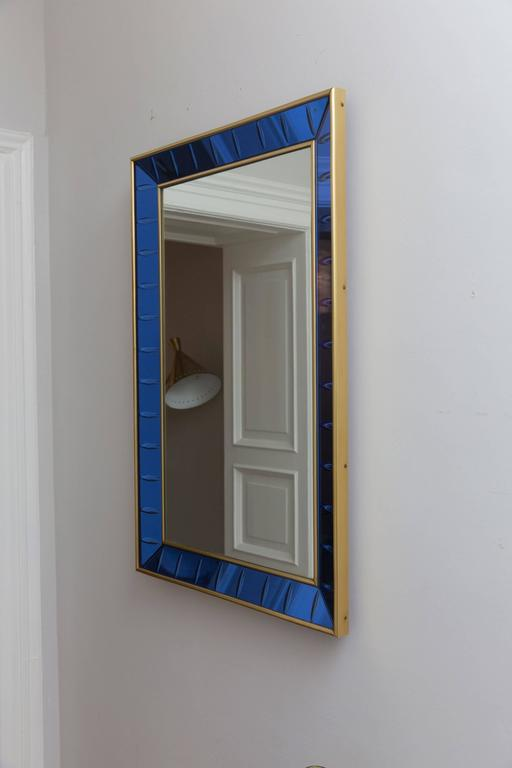 Elegant wall mirror, prod. crystal art, Italy, circa 1960, blue glass, lentil cut, brass frame, mounted on wooden frame, mirror glass. Measures: Height 90 x length 60 x depth 6 cm. Perfect condition, perfect glass condition.