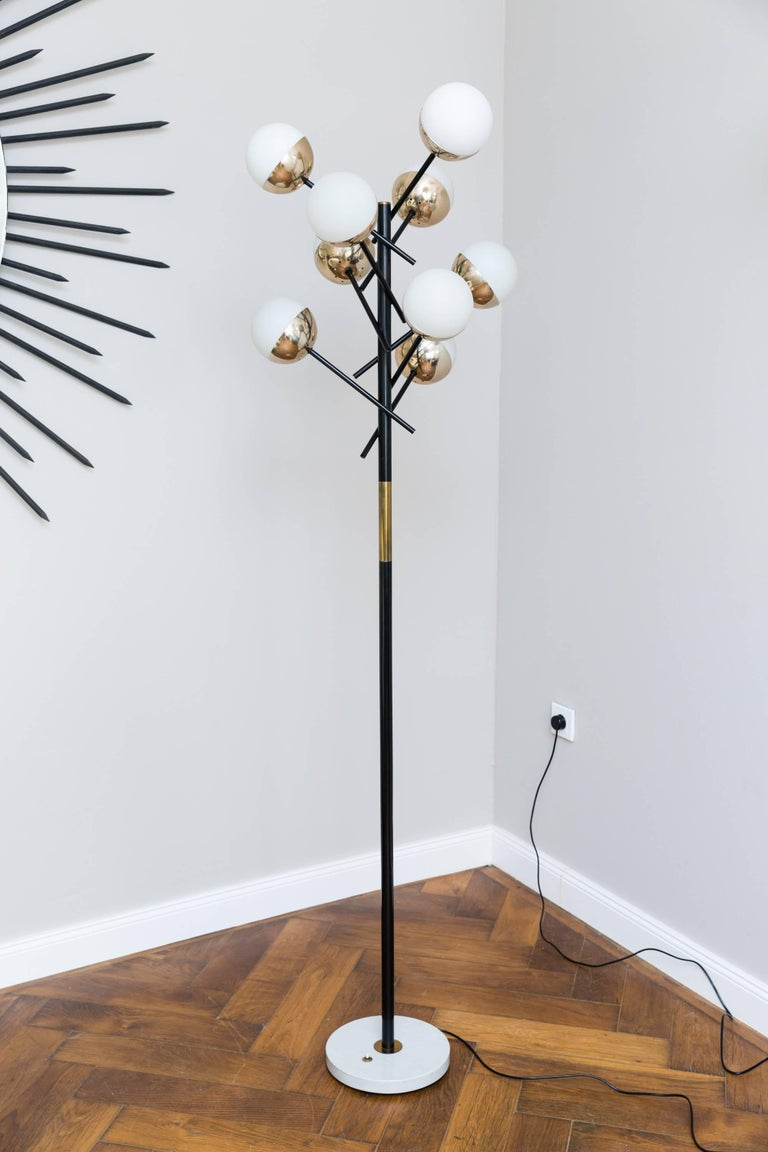 Very elegant and rare floor lamp by Stilnovo, Italy, circa 1955, enamelled metal, brass, marble base, nine opal cased glass diffusers. Measures: Height 185 cm, diameter 53 cm, diameter marble base 30 cm, rewired, very good original vintage