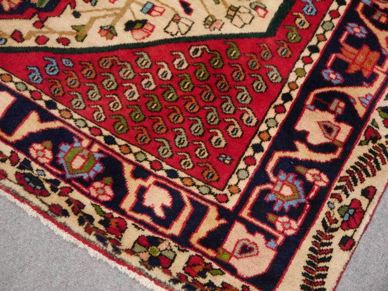 Tribal rug 6.8 x 4.8 ft / 204 x 143 cm Bohemian Boho style carpet vintage Afshar tribal beige red green blue  This tribal rug was made by women on the eastern side of the Zagros mountains. It was hand knotted in the 1960s using fine handspun wool
