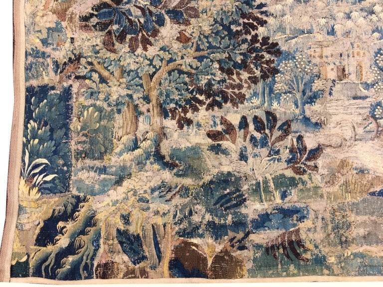 Beautiful antique French Gobelin tapestry. Hand woven with wool and silk in France circa mid-18th century in a workshop in Paris or Verdun. The design shows a Mediterran Garden Scene with a building in the centre, surrounded by palm trees. Around