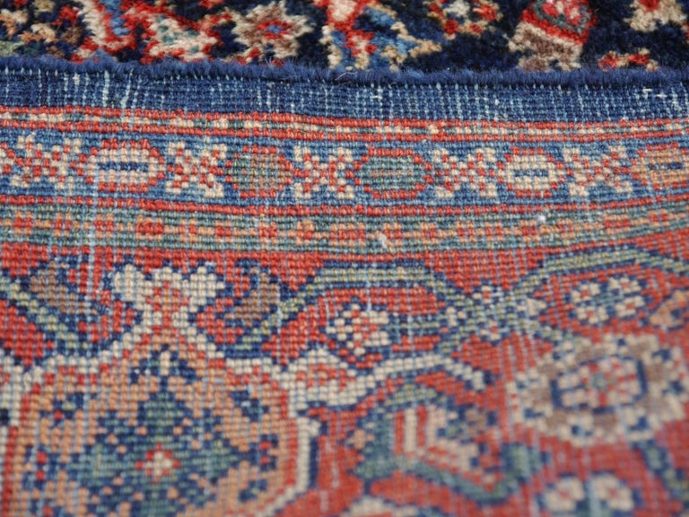 A fine and hand-knotted antique rug in very good condition. It has very good pile condition, is soft and has a beautiful luster - a perfect interior design rug. Lower pile at the edges.