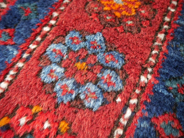 Hand-Knotted Shirvan Caucasian Vintage Carpet with Vibrant Colors Red Blue Orange Green For Sale