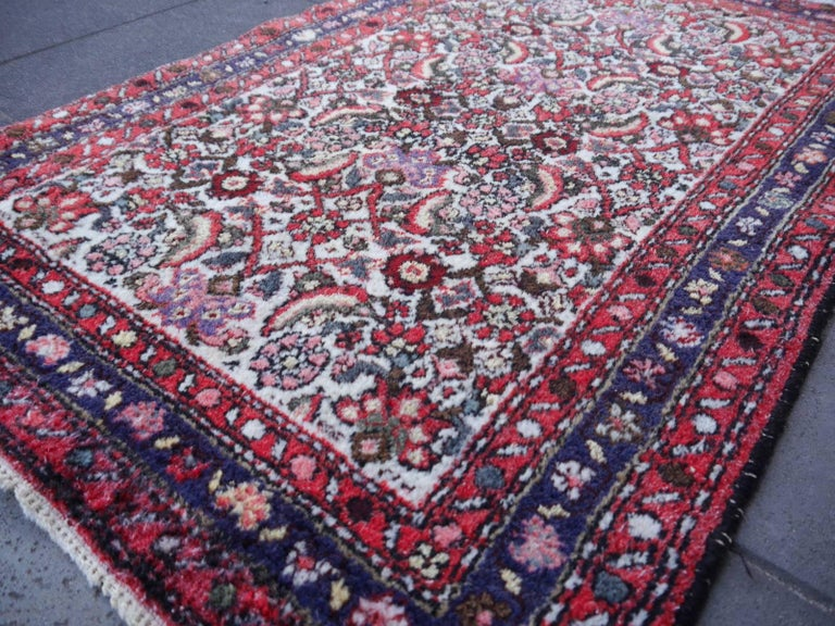 Vintage oriental accent rug beige red blue • Beautiful vintage rug • All handmade • Pile pure wool • Traditional design • Condition: Very good.  All of our rugs, carpets and Kilims are original vintage or antique pieces. They are hand washed