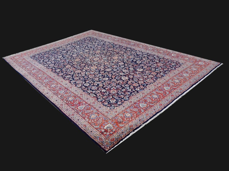 A hand-knotted semi antique oriental carpet from Yazd, a town in desert Lut. Yazd rugs and carpets are famous of their great quality, their beautiful Classic design and their tasteful colors.  This rug was made midcentury and it is in very nice