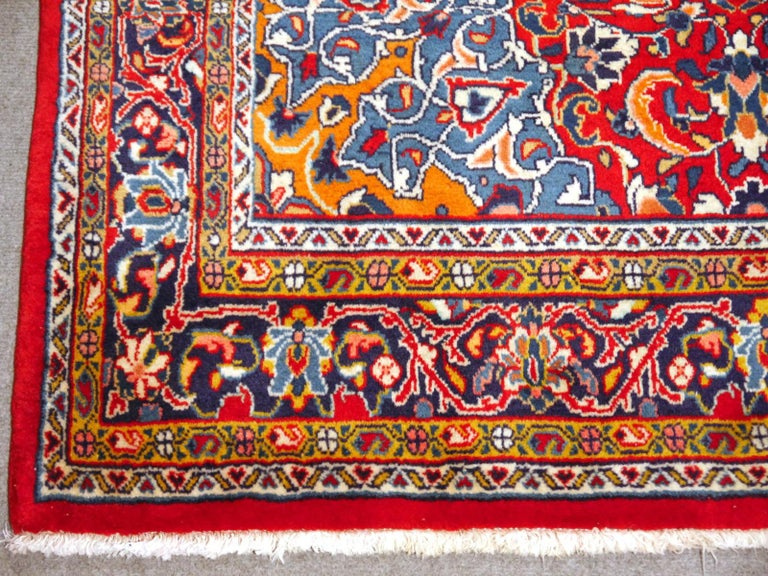 A hand-knotted Oriental rug in red and blue, made in the 1970s. Pile is pure wool, warp and weft is cotton. The rug is in very good condition with vibrant colors.