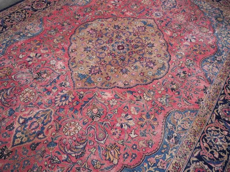 A beautiful antique Persian Tabriz. This unusual colored Persian Tabriz Carpet was hand knotted in the province of Azerbaijan in north-western Persia. It has a classic oval center design with is referred to as a style first made by the Haji Jalili