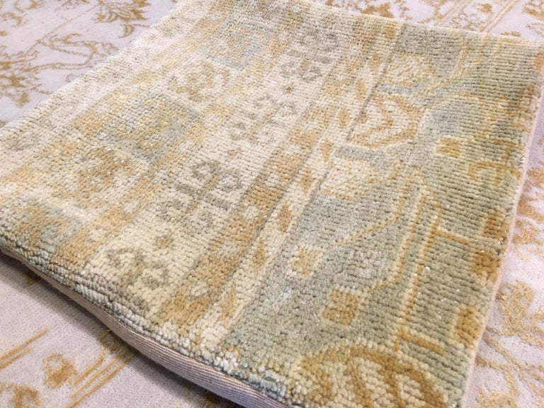 Beautiful hand-knotted Khotan design rug pillow cover, wool pile. Nice faded color, backing is cotton textile, with zipper. Comes without filling.