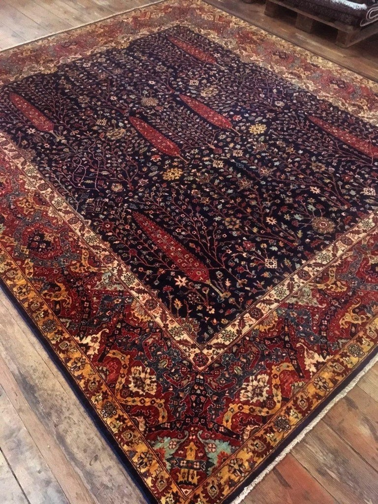 This new Afghan carpet was hand-knotted using finest hand spun and vegetable dyed wool. The design shows an antique Bakhshaish rug motive with a banded border and trees of life in the centre. It has a very dense knotting and a silk like luster.