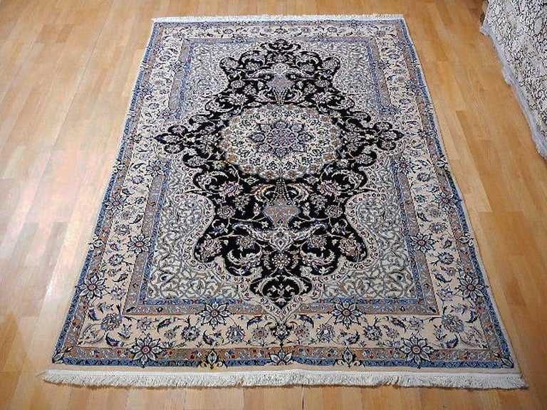 Very fine Persian Nain rug in kurkwool and wilk pile, about 600 knots per square inch. Elegant and decorative formal rug.