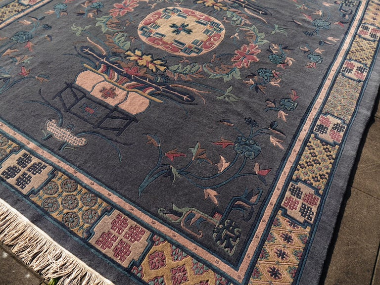 This vintage traditional Tibetan carpet was hand knotted using finest wool. The design shows Medaillon and lucky charm symbols that are common in Tibet and China. The pile is extra fine, hand spun Tibetan Highland wool that comes from a special