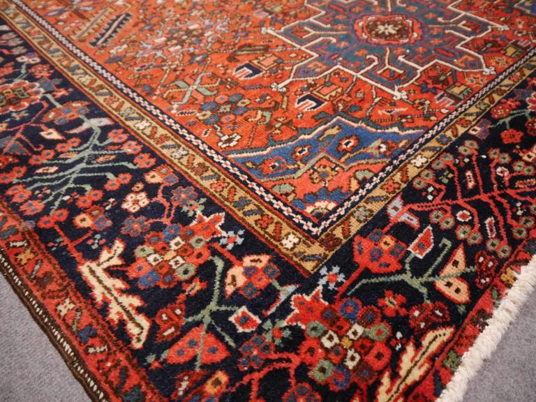 Beautiful semi antique Persian rug from the north western part of Persia. This stunning traditional Karaja was made near the city of Heriz. The rug is in very good condition with low pile.
