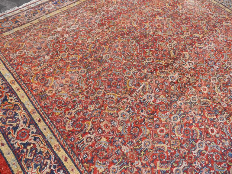 Beautiful antique Persian rug from the Mahal / Sultanabad region in western persia. Fantastic colors and it´s authentic look make this rug light up any room.  Low pile, narrow ends newly secured. Distressed / worn industrial style look.
