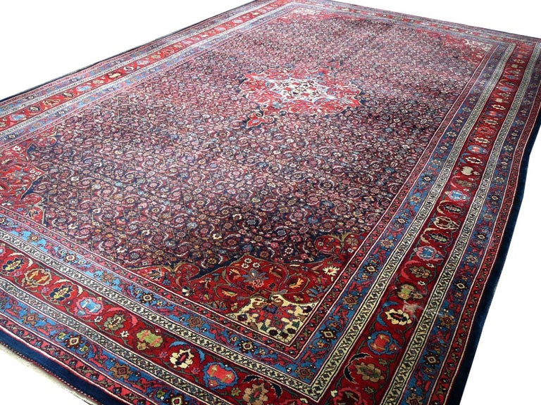 For sale is a rare and beautiful Persian Bidjar carpet. It is very large and in fantastic condition. All-over the carpet the fine and natural dyed wool pile is evenly high, no worn areas, holes or tears. All four sides are in original condition, the