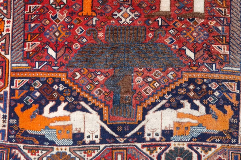 This is a tribal Qashqai rug, hand-knotted by women of the tribal people south east of the Persian city of Shiraz. It was made in the 1960s using hand spun Persian highland sheep wool from the Zagros mountains. 