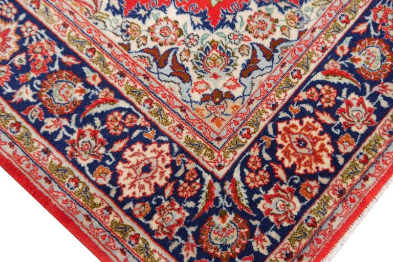 This fine hand-knotted Persian rug was made in the city of Isfahan / Esfahan in central Iran. Isfahan rugs are well-known for their fine and skilful detailed work. This rug was made in the 1970-1980 and is in very good condition. It has about 600
