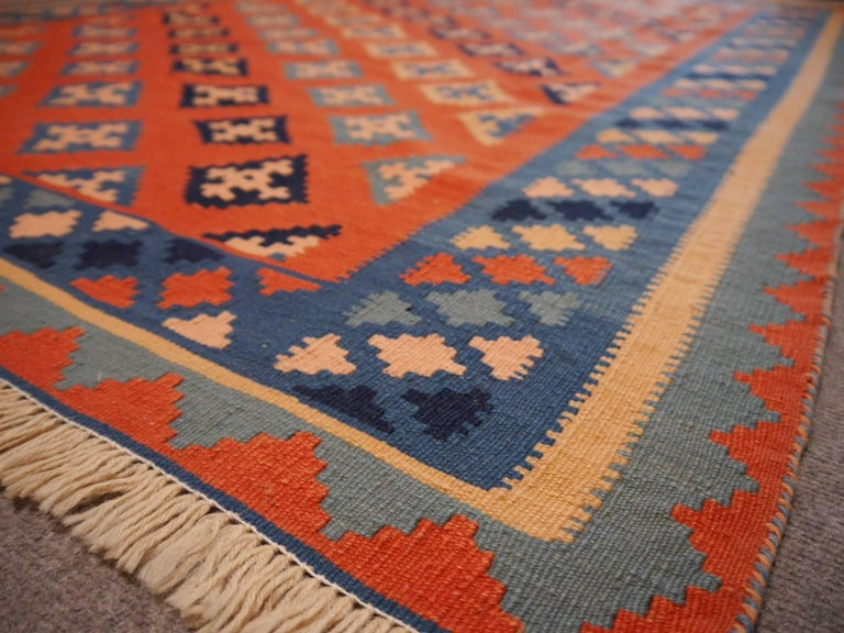 This handwoven Persian Kilim rug was hand woven by women of the Qashqai tribe in southwest Persia. 
