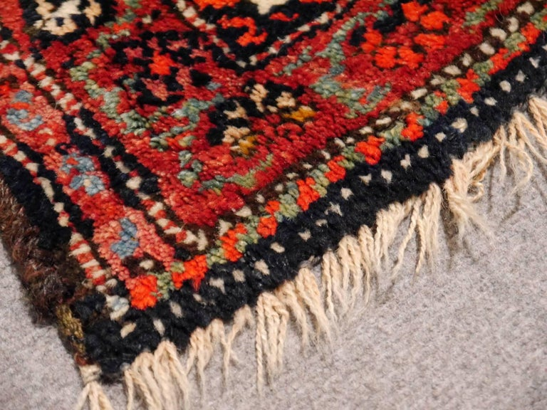 This hand-knotted antique Persian tribal rug was hand made by women of the Qashqai tribe in southwest Persia.   Qashgai tribal rugs are always decorative and colorful works of art, mainly using the colors red (made from the Ronnas plant), blue