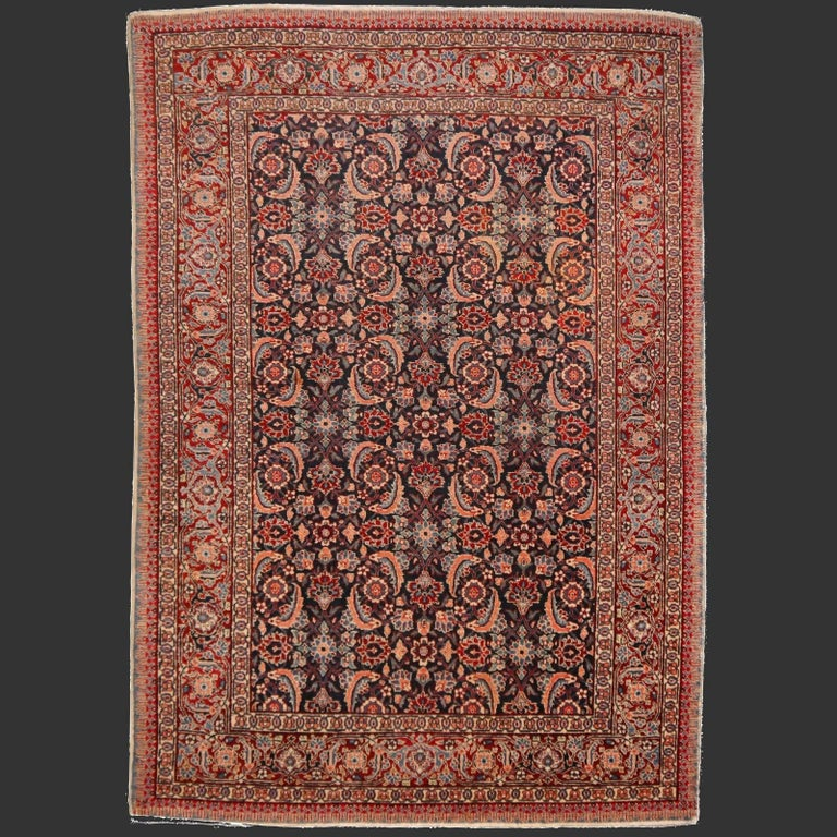 Wool Antique Rug Mahi Design Haji Style Blue and Red Allover For Sale