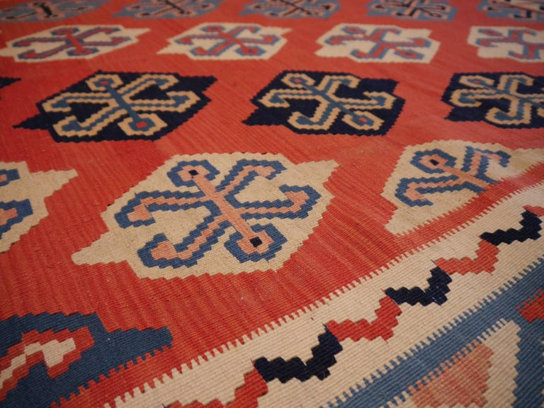 This handwoven tribal Kilim rug was made by women of the Qashgai tribe in the Zagros mountains in southern Persia. The wool used for this rug comes from highland sheep; the dyes used are all natural / vegetable dyes. The Kilim is in very good