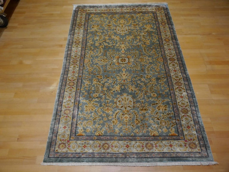 This is a very lovely oriental rug made in eastern region of Turkestan / Chinese border area. it is a so called Khotan carpet. These rugs have a fine hand-knotted structure, usually made of wool on a cotton foundation. This rare example is all pure