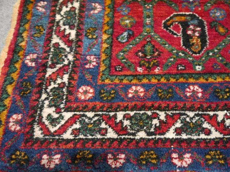 This beautiful Persian vintage semi antique carpet was made in the south - eastern part of Persia in the Kerman region. It was hand-knotted by women of the Afshar tribe using fine hand-spun highland wool for the pile and cotton for the warp and