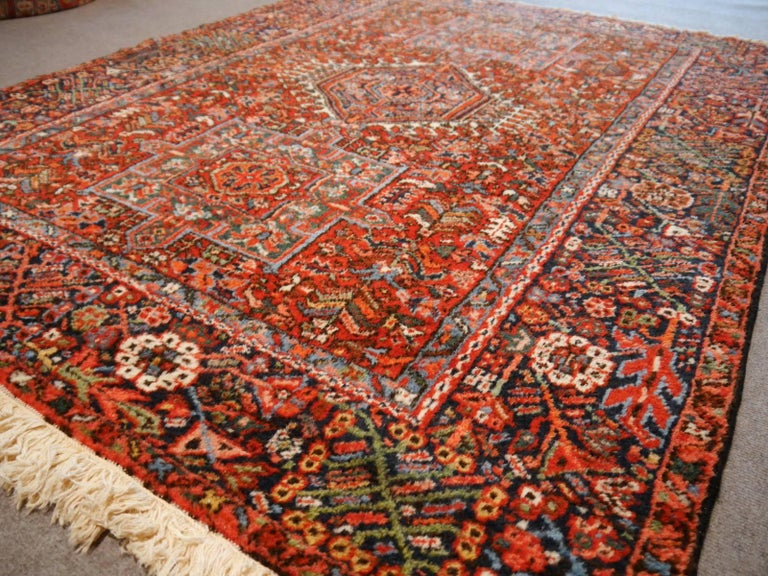 A beautiful antique Persian Heriz Karaja rug, hand-knotted and in very good condition. It has full pile and beautiful colors.