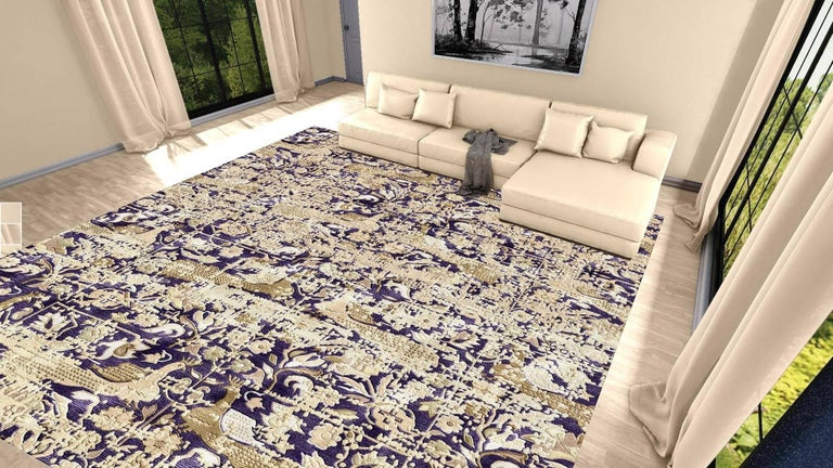 A beautiful oversized contemporary design carpet, hand-knotted using finest Chinese mulberry silk. On a blue field, the design of peacocks standing next to each other executed in beige and mud tones. The blue background color is lower in pile, the