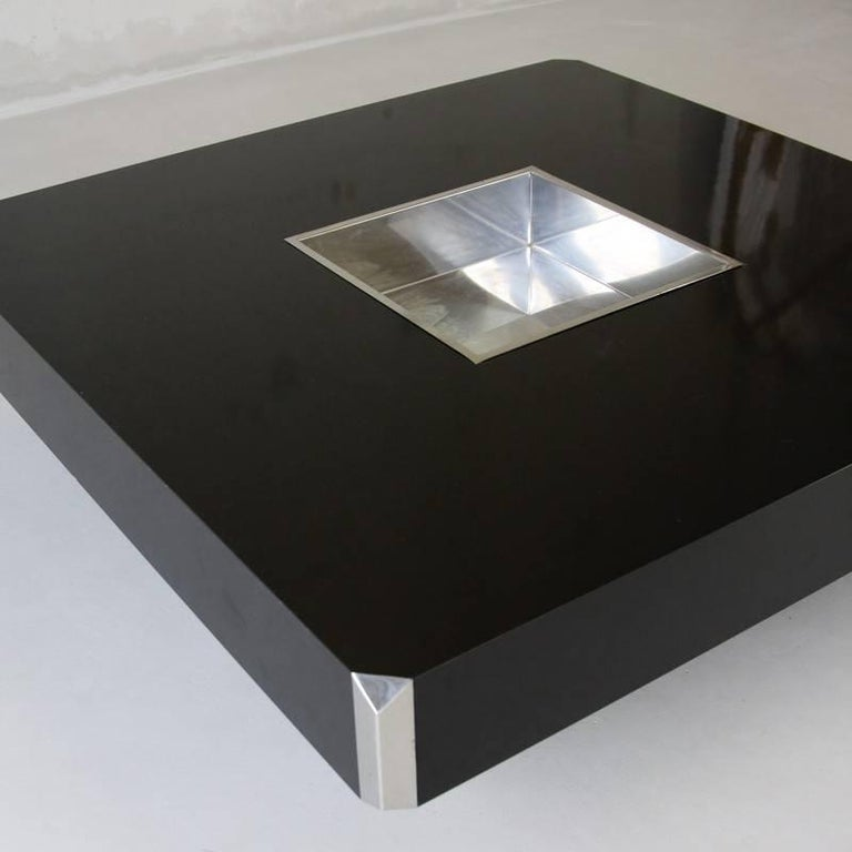 """Large square black laminate coffee table designed by Willy Rizzo and produced by Mario Sabot, Italy 1972. With metal centre storage insert.  Reference: Maison & Jardin, septembre 1973, p. 131 """"Le retour de Willy Rizzo"""", AD, n°86, septembre 2009,"""