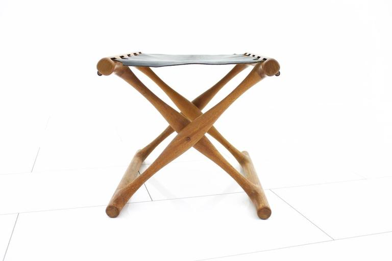 Folding stool by Poul Hundevad, PH 43. Solid teak and black leather.