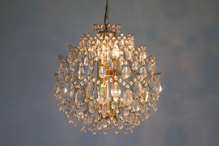 European Swarovski Crystal Glass and Gold Chandelier, 1970s For Sale