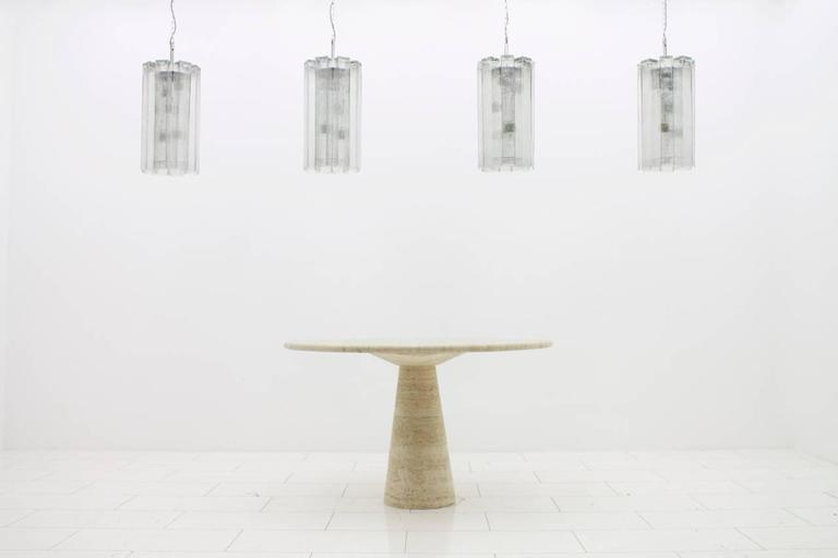 Set of eight glass chandeliers by Doria.  High glass tubes per chandelier with a length of 50 cm per item.  Measurements: Total height with chain 165 cm, without the chain 64 cm,  Glass tubes: 6 x 6 x 50 cm.  Excellent condition.  Worldwide