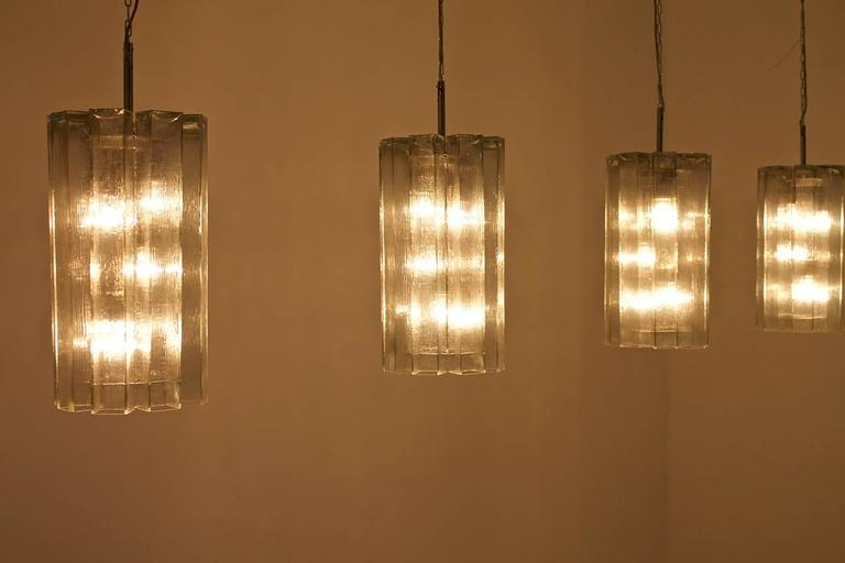 Mid-20th Century Set of Eight Large Glass Chandeliers by Doria, 1960s For Sale