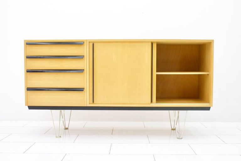 Rare sideboard by Alfred Altherr for Freba, Switzerland, 1955. Cherrywood and black lacquered wood grips and white metal legs. Measures: W 165 cm, H 87.5 cm, T 48 cm.  Very good condition.  Worldwide shipping.