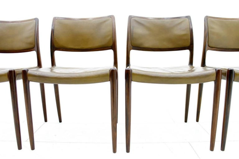 Rare set of four Niels O. Møller dining room chairs model 80 with beautiful brown leather. Good original condition with great patina.   Worldwide shipping.