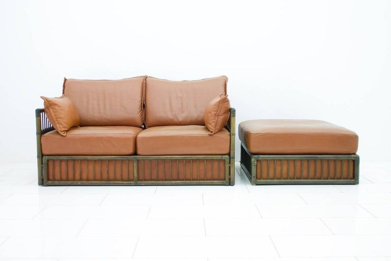 Hollywood Regency Two Person Leather Sofa and Foot Stool with Rattan For Sale