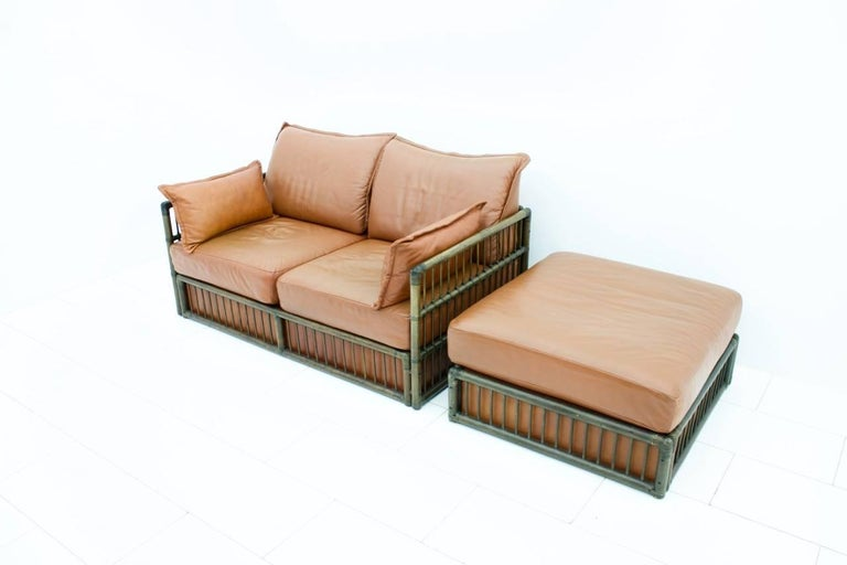 German Two Person Leather Sofa and Foot Stool with Rattan For Sale