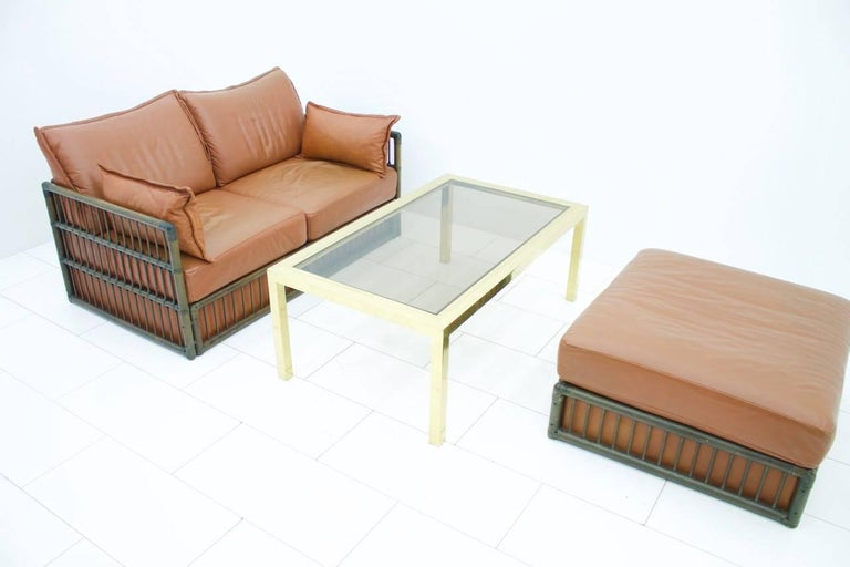 Late 20th Century Two Person Leather Sofa and Foot Stool with Rattan For Sale
