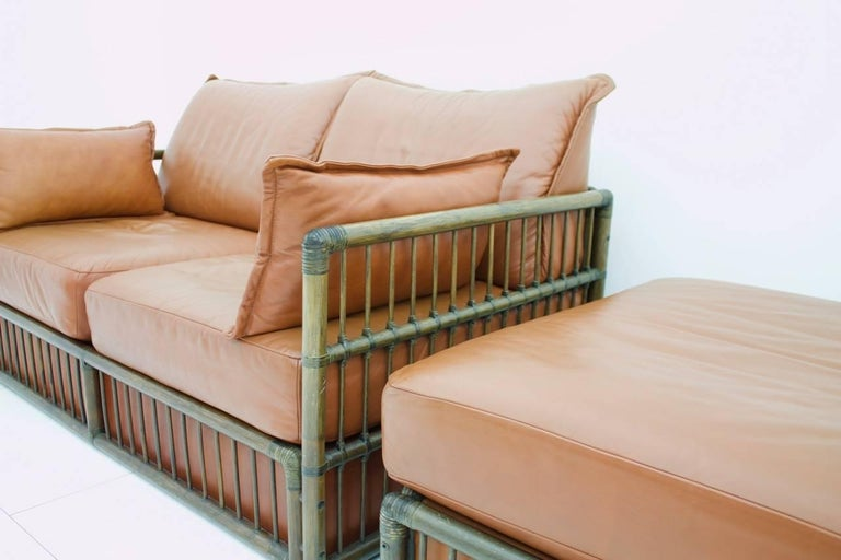 Two Person Leather Sofa and Foot Stool with Rattan In Good Condition For Sale In Frankfurt / Dreieich, DE