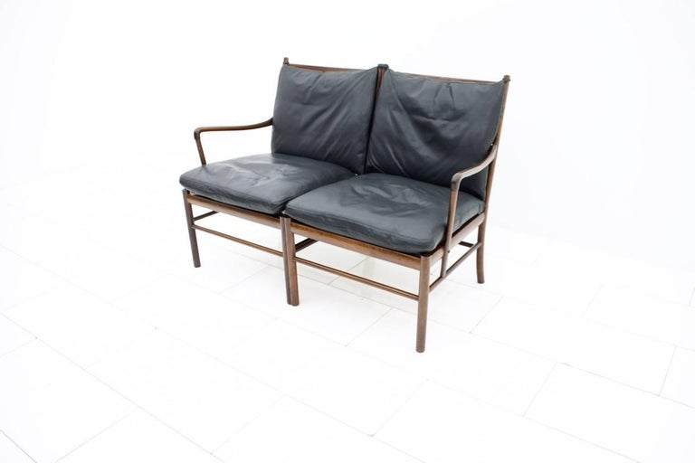 Ole Wanscher colonial settee PJ149 Poul Jeppesen made of wood and black leather cushions with down-fills. Very good original condition.