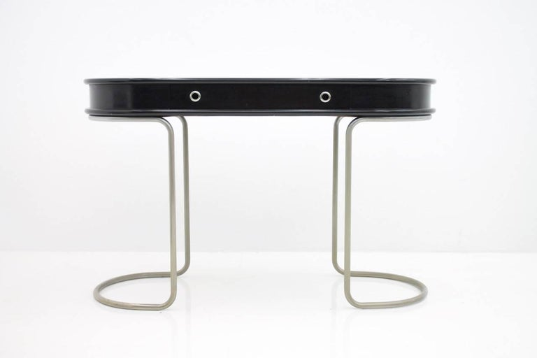 Nice light ladies desk or console table with one drawer. Black lacquered wooden body on tubular steel frame probably nickel-plated.