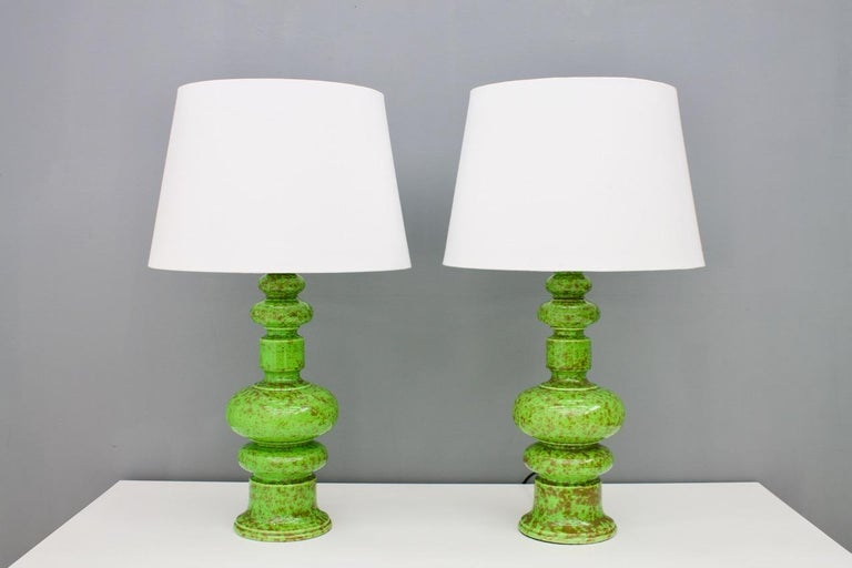 Nice pair of green ceramic table lamps from the 1970s. Very good condition.