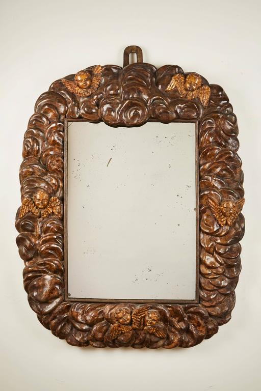 An extraordinary carved Italian polychrome mirror. Original candleholders can be removed as depicted in the picture. 